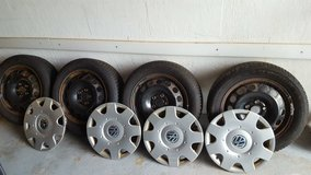 VW Winter Tires 205/55 R16 w/ Rims & Hubcaps in Ansbach, Germany