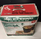Safari Qwik-Cook Round Tailgate Portable BBQ Grill Uses Newspaper in Bolingbrook, Illinois