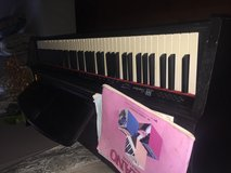 Piano and bench in Westmont, Illinois