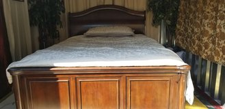 Queen Size chestnut brown hard  wood bed with mattress set in Clarksville, Tennessee