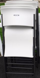 Like New! Set of 4 White Lifetime Plastic Seat Metal Frame Folding Chairs in Naperville, Illinois