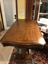 Bar height dining table with 8 chairs in Conroe, Texas