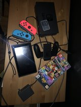 NINTENDO SWITCH BARELY USED w/ games and extra gb storage in Naperville, Illinois