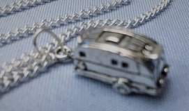 Camper Pendant Detailed on Stainless Steel Chain in Kingwood, Texas