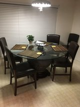 Glass dining table with 5 chairs in Beaufort, South Carolina
