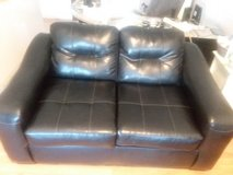 Black leather loveseat in Fort Campbell, Kentucky