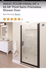 """Re:  Brand new, in box, never installed Basco shower door in oil-rubbed bronze. 34"""" x 65.5"""" in Westmont, Illinois"""