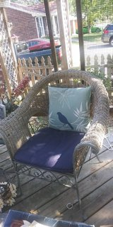 Patio chair with cushion in Fort Campbell, Kentucky