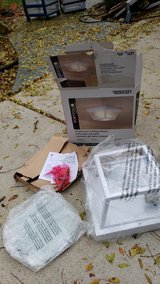 Outdoor light fixture missing glass shades in Chicago, Illinois