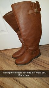 Tan knee-high boots in Alamogordo, New Mexico