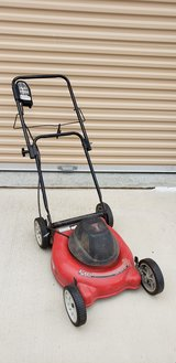 ELECTRIC MOWER uses a cord in Camp Pendleton, California