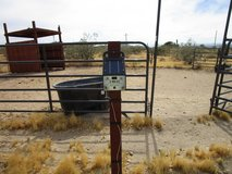 Solar powered electric fence in Yucca Valley, California