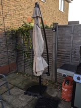 Folding Garden Parasol/w 2 base plates in Lakenheath, UK