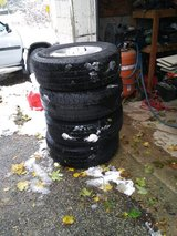 "Set of four 17"" Wrangler tires and rims in Naperville, Illinois"