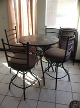 Tile table with 4 chairs and baker's rack in Alamogordo, New Mexico