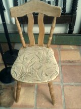 Wood chair with cloth seat in Alamogordo, New Mexico