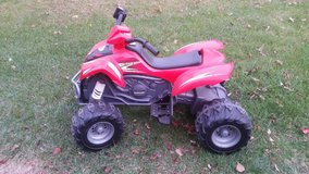 Red KFX Kawasaki Monster Traction 12 VOLT in Chicago, Illinois
