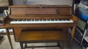 Lowrey upright piano and bench in Orland Park, Illinois
