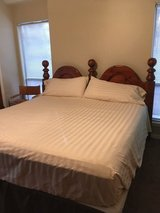 King size bed with headboard, sheets and pillows in Kingwood, Texas