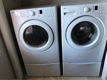 LG Washer & Dryer w/ pedal stool (appliance - by owner) in Warner Robins, Georgia