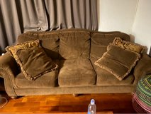 Brown couch with throw pillows in Okinawa, Japan