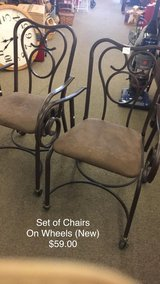 Set of Chairs (New) on wheels in Fort Leonard Wood, Missouri