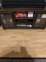 Solid wood tv stand w/glass doors in Stuttgart, GE