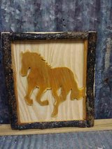 wooden horse  tree branch framed in Cleveland, Texas