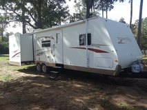 2009 surveyor by Forest River 32 foot bumper pull with double slide outs i in Tomball, Texas