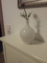 white IKEA Salong vase with flower in Ramstein, Germany