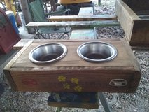 Dog bed and food dish in Leesville, Louisiana