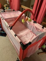 Baby folding play pen with changing table and bassinet in Chicago, Illinois