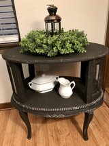 Antique side table with glass panels in Kingwood, Texas
