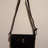 Stylish black slim handbag in Ramstein, Germany