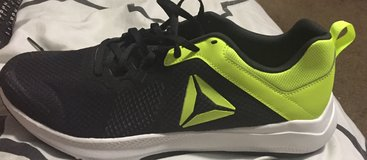 Lime green and Black Reebok tennis shoes in Fort Lewis, Washington