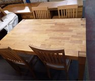 Solid wood kitchen table with 4 chairs. 140cm by 90cm in Lakenheath, UK