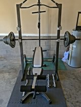 Marcy cage and bench with 300+ lbs olympic weight set in Fort Campbell, Kentucky