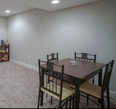 Dining room table and chairs in Fort Riley, Kansas