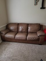 Brown leather couch in Kingwood, Texas