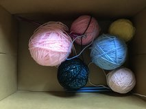Yarn and two sets of knitting needles in Kingwood, Texas