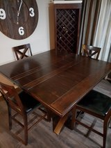 "59""x 59"" x 36"" Counter Height Dining room table with hidden leaf in Tacoma, Washington"