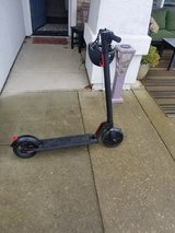 Gotrax Gxl Electric Scooter with Black Helmet in Travis AFB, California