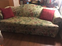 Floral couch and claw foot chair in Travis AFB, California