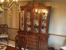 Cherry dining room table and china cabinet in Chicago, Illinois