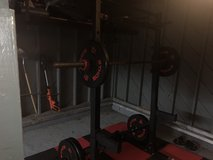 Squat rack, barbell with 2x 45 plates, 25, 10 bumper. Bowflex adjustable dumbbells and perfect p... in Hopkinsville, Kentucky