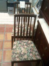 Brown wood chair with cloth seat in Alamogordo, New Mexico