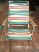 Outside folding chair with wood arms in Alamogordo, New Mexico