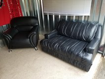 Black leather loveseat and oversized chair in Fort Campbell, Kentucky
