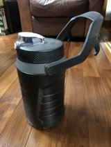 large drink thermos with hanging handle in Okinawa, Japan