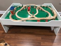 Wooden toy train table with train set in Joliet, Illinois